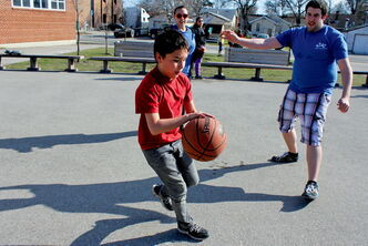 Edmund Partridge student Tomas Brown tries to deke KYAC volunteer Nathan Boutin during a game of basketball last week.
