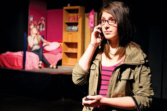 Maples Collegiate students Paulina Groele (right) and Kristy Watling rehearse a scene from the school's upcoming production of Mean Girls.