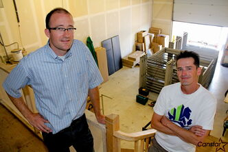Rob McLeod (left) and Joe Boulard in the warehouse of Operation Share.