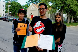 Romondo Nilles (centre), along with Holden Lynxleg and Marianna Lathlin, were out collecting signatures near Pritchard Avenue last week to support the creation of a 24-hour drop-in centre for youth.