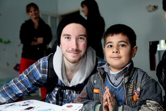 Oak Park High School student and YouTube sensation Sean Quigley (left) with a World Vision-sponsored child he met during a recent trip to eastern Europe.