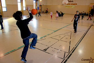 Jonah, 10, bounces a ball to his friend Nathan at the R.A. Steen Community Centre last week.