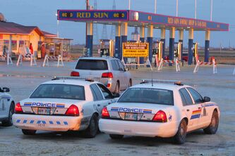 At least four police cars were on scene at the Red Sun gas bar on Highway 6 as staff members were evicted Wednesday night.