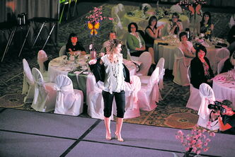A participant at last year's Garden Party Fashion Show for Habitat for Humanity Manitoba struts her stuff on the catwalk.