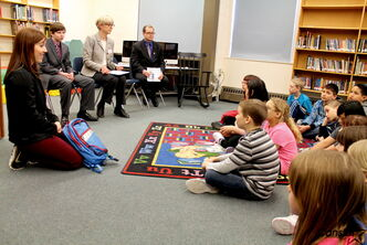 Physiotherapist Monique Martin, left, demonstrates a new backpack for children with JIA to students at Crestview School as Colin Johnson (from left), The Arthritis Society's Lynne McCarthy, and Jim Rondeau (MLA for Assiniboia) look on.