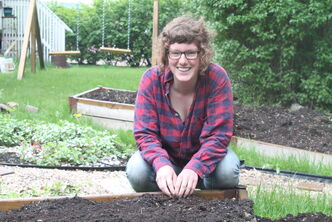 Kalynn Spain, in her Wolseley front yard, will document more than 60 farms in an effort to create a new online directory of local/sustainable food options.
