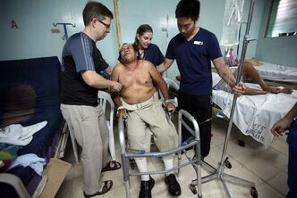 Members of the Operation Walk surgical team from Winnipeg help a patient in Nicaragua in October 2012. The Walk of Life feature by Phil Hossack and Melissa Tait took a silver medal in the best multimedia feature category at the 2013 Canadian Online Publishing Awards on Nov. 13.