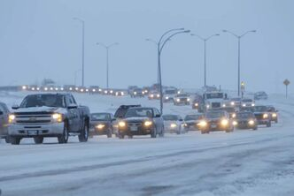 A long line of traffic enters the city on slippery roads this morning.