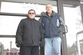 Citizens for Crime Awareness District 4 president Tony Sorto and vice-president Rudy Puttkamer are shown outside the WInnipeg Police Service's community service centre at 1400 Henderson Hwy., which closed last month.