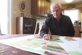 East St. Paul resident Brian Duval is shown with a zoning map of the entire rural municipality. Duval is heading up a group of residents fighting to prevent council from allowing 8,000-square-foot lot sizes.