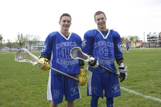 River East Kodiak co-captains Coleton Benn and Matthew Allen are shown before a Manitoba High School Field Lacrosse League playoff game against Portage on May 30.