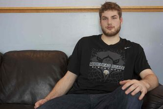 Chad Posthumus is shown at his family's home in East St. Paul.