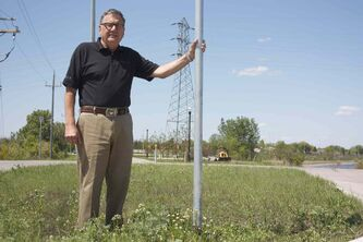Ultra Transmission owner and president Ken Hobson is shown at the roundabout at Springfield Road's terminus just east of Chief Peguis Trail.