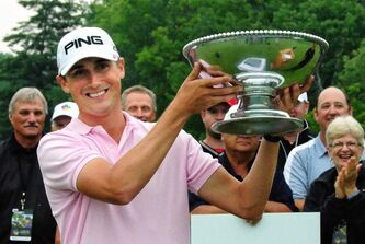 Chris Killmer from Bellingham, WA hoists the Players Cup after finishing on top on the final day at Pine Ridge in July 2012.