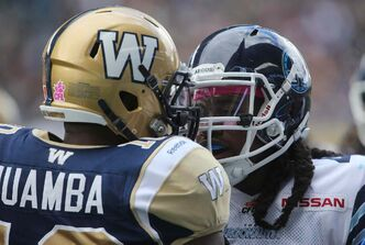 Winnipeg Blue Bombers' Henoc Muamba (10) and Toronto Argonauts' Jonathan Hood (41) get in each other's faces during the first half of CFL action at Investors Group Field Saturday.