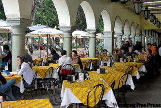 Cafes in the zocala are popular for dining day and night.