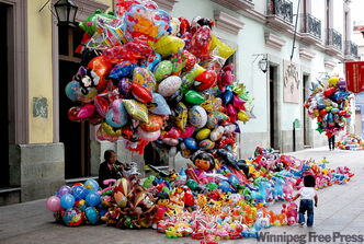 Balloon sellers in the zocala in Oaxaca, one of Mexico's finest and most colourful cities.