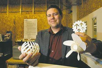 Michael Legary holds prototypes made at  AssentWorks on Adelaide Street. Legary is one of the finalists in the BDC�s Young Entrepreneur of the Year Award.