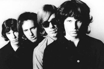 Members of the Doors, John Densmore (from left), Robbie Krieger, Ray Manzarek and Jim Morrison, pose for a portrait. Manzarek, the keyboardist who was a founding member of The Doors, has died in Germany at the age of 74.