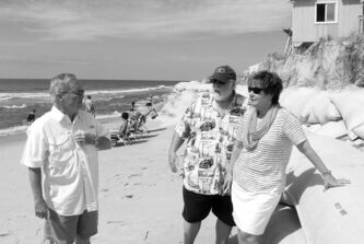 North Carolina State Rep. Frank Iler (left), Mayor Harry Simmons of Caswell Beach and Mayor Debbie Smith of Ocean Isle Beach discuss coastal erosion.