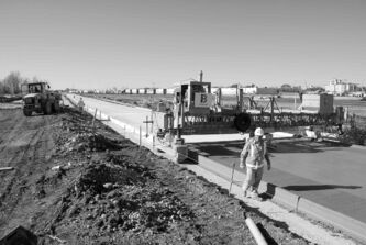 Crew members work on Winnipeg�s southwest rapid transit corridor in 2011.