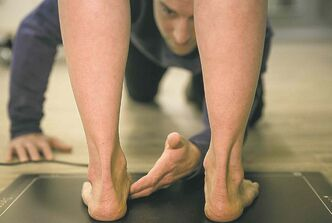Tim Shantz conducts a foot exam.