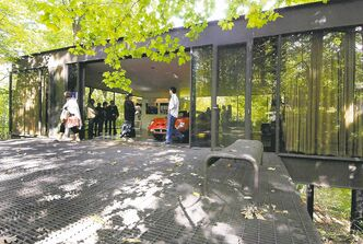 This Oct. 4, 2009 photo shows visitors touring the pavilion in the back of the modernist home in Highland Park, Ill., that was featured in the movie