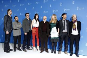 Members of the Jury, from left Anton Corbijn, Asghar Farhadi, Jake Gyllenhaal, Charlotte Gainsbourg, Jury president Mike Leigh, Barbara Sukowa, Francois Ozon and Boualem Sansal pose at the jury photo call during the 62 edition of International Film Festival Berlinale, in Berlin Thursday, Feb. 9, 2012. (AP Photo/Markus Schreiber