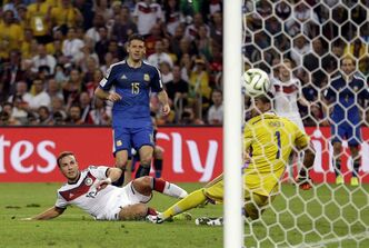 Germany's Mario Goetze scores the eventual winner in extra time against Argentina goalkeeper Sergio Romero on Sunday in Rio de Janeiro. The goal gave Germany its first World Cup title since 1990.
