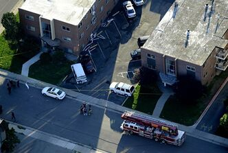 "Emergency crews, including a bomb squad unit, surround the apartment of alleged gunman James Holmes Saturday, July 21, 2012 in Aurora , Colo. The ""water shot"" is exploded and used to disrupt the device. Authorities reported that 12 died and more than three dozen people were shot during an assault at a movie theatre midnight premiere of ""The Dark Knight Rises."" (AP Photo/The Denver Post, Andy Cross) TV, INTERNET AND MAGAZINES CALL FOR RATES AND TERMS"