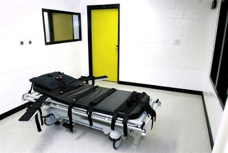 "The death chamber at the state prison in Jackson, Ga., is shown on Oct. 24, 2001. Amid the cacophony resulting from the George Zimmerman verdict in Florida this weekend, another startling legal saga has been playing out in nearby Georgia, where a mentally disabled man is scheduled to be executed on Monday. Warren Lee Hill, deemed ""mentally retarded"" by state doctors, has been serving a life sentence for killing his girlfriend. That sentence was upgraded to a death sentence after he killed his cellmate in 1990 by bludgeoning him as he slept with a nail-studded board. THE CANADIAN PRESS/AP - Ric Feld"