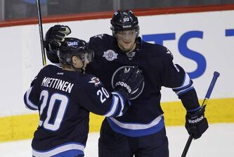 The Winnipeg Jets'  Nik Antropov (80) and Antti Miettinen celebrate a goal by Antropov against the Carolina Hurricanes last March.