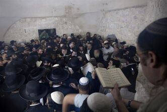 Ultra-Orthodox Jewish men pray at Joseph's Tomb in the West Bank city of Nablus, early Monday.
