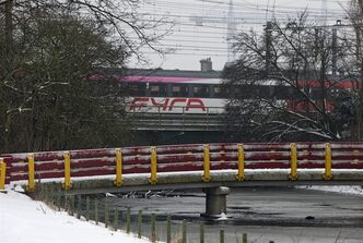 "A Fyra high-speed train, shunted by a locomotive passes a bridge on its way to a railroad siding in Amsterdam, Netherlands, Monday Jan. 21, 2013. When railroad bosses proudly unveiled their new Fyra train connecting Amsterdam and Brussels they called it the ""missing link"" in Europe's high-speed rail network. Now, the Italian-built trains are missing in action. Technical problems dogged the 250-kmh (155-mph) trains since they came into service last month, repeatedly delaying trips between the Dutch and Belgian capitals that were supposed to shave more than an hour off the regular intercity service the Fyra replaced. (AP Photo/Peter Dejong)"