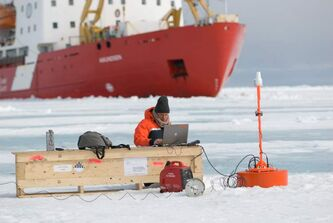 Dr. Klaus Hochheim sets up a portable research station on the Arctic ice during a trip on the Amundsen in 2008. Hochheim died in a helicopter crash near the Amundsen this week,
