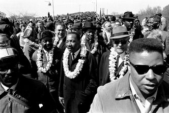 Martin Luther King, Jr. and supporters of the civil rights movements march through Alabama in March 1965. Art DeFehr was among those who marched.