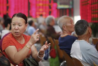 An investor gestures at a private securities company Monday, Aug. 26, 2013 in Shanghai. THE CANADIAN PRESS/AP