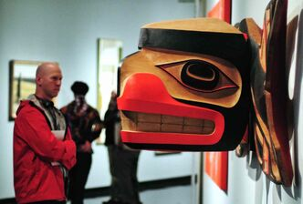 The Winnipeg Art Gallery was packed as art lovers flocked to 100 Masters: Only in Canada at the Winnipeg Art Gallery. A visitor to the gallery looks at the  wooden sculpture by Robert Davidson titled, Killer Whale Transforming into a Thunderbird, 2009.