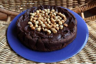 Nigella's Nutella Cake is a 'perfectly imperfect' delight with incredibly moist texture and deep chocolatey taste.