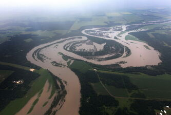 The Assiniboine River overflows its banks, flooding roads and farm fields west of Portage la Prairie.