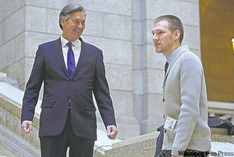Former premier Gary Doer chats with Youth Parliament  Premier Darcy Vermeulen on Monday.