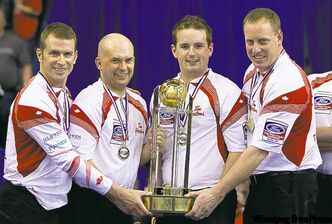 Canada skip Jeff Stoughton (left to right) third Jonathan Mead, second Reid Carruthers and lead Steve Gould celebrate their team's gold medal win over Scotland at the Ford World Men's Curling Championships in Regina, Sask., Sunday, April 10, 2011.