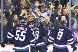 Winnipeg fans and Jets Mark Scheifele, Blake Wheeler and Evander Kane celebrate Wheelers' second-period goal Tuesday night.