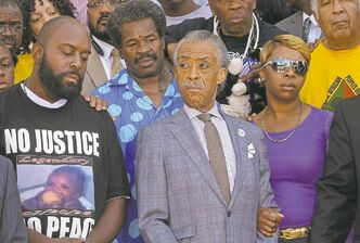 J.B. Forbes / The Associated PressMichael Brown Jr.�s parents, Michael Brown Sr. (left) and Lesley McSpadden (right), with Rev. Al Sharpton on Tuesday in St. Louis.