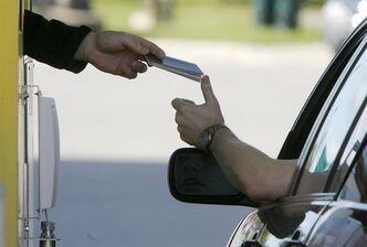Maryscott Greenwood, an American international trade expert and senior adviser to the Canadian American Business Council, said there's no question 9-11 fears about Canada resulted in heightened security measures that posed serious hardships for citizens, businesses and manufacturers on both sides of the border. A driver is shown handing his passport to a border agent at the U.S. border crossing in Highgate Springs, Vt., Monday, June 1, 2009. THE CANADIAN PRESS/AP-Toby Talbot