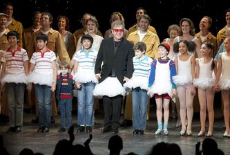 Sir Elton John wears a tutu as he joins the cast of the musical Billy Elliot for the curtain call following the show's premiere in Toronto in 2011. He wrote the music for the show, which will make its Winnipeg debut in 2016.