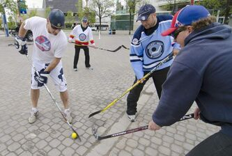 Winnipeg hockey supporters get in on some street hockey action at The Forks early Tuesday May 31, 2011 prior to the True North Sports & Entertainment news conference.