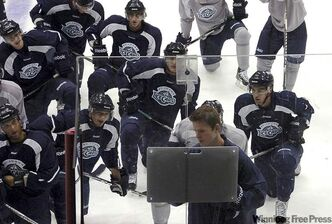 St. John's IceCaps head coach Keith McCambridge uses a white board to map out plays for his players in St. John's,  Tuesday, Sept. 27, 2011 on the first day of training camp for the new AHL team. THE CANADIAN PRESS/St/John's Telegram-Gary Hebbard