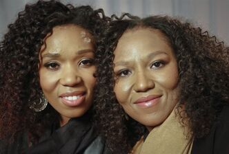 In this Wednesday, Feb. 6, 2013 photo, Swati Dlamini, left, and Zaziwe Dlamini-Manaway, granddaughters of Nelson and Winnie Mandela, pose during an interview in New York. The sisters are stars of the new reality show