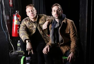 "Macklemore, left, and his producer Ryan Lewis at Irving Plaza in New York. The rapper Macklemore thinks there's a simple reason his hit ""Thrift Shop"" appears to be going viral: It dares to be different. The Seattle-based duo has sold 2.3 million copies so far - a million in the last month alone - and sales continue to grow week to week. (Photo by Carlo Allegri/Invision/AP, file)"